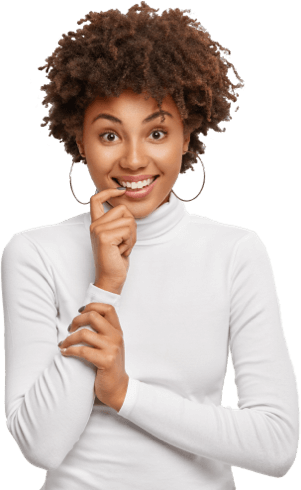 shot-pleasant-looking-dark-skinned-curly-woman-holds-finger-near-mouth-smiles-broadly-looks-positively-has-partly-crossed-arms-wears-earrings-turtleneck-isolated-white